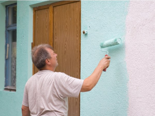 Man-painting-a-stucco-house.jpg